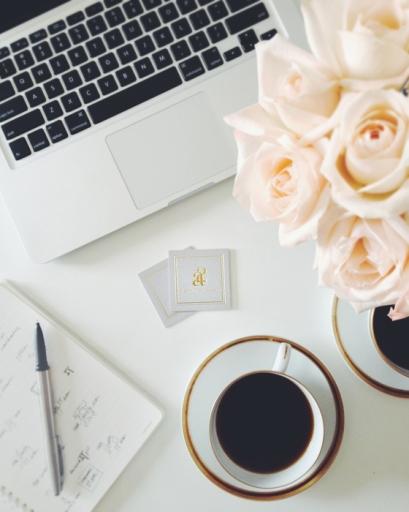 small-shop-for-a2-photo-shoot-desk-vignette-overhead-biz-cards-roses-coffee-laptop